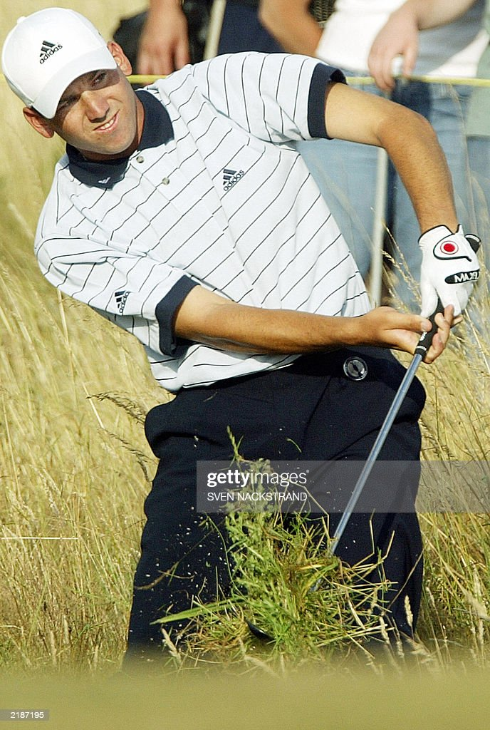 Undergrowth follows the club of Spanish golfer Sergio Garcia playing out of the rough on the 17th hole during the third round at The Open...