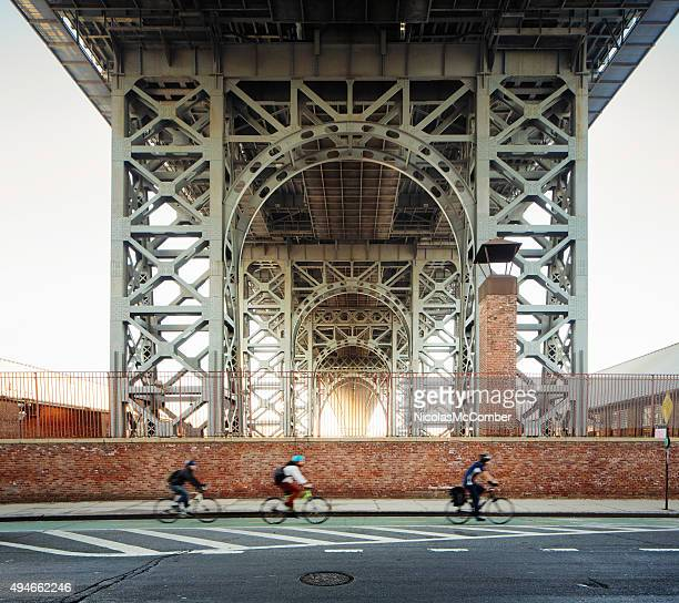 Underneath the Brooklyn Williamsburg bridge morning with bikers