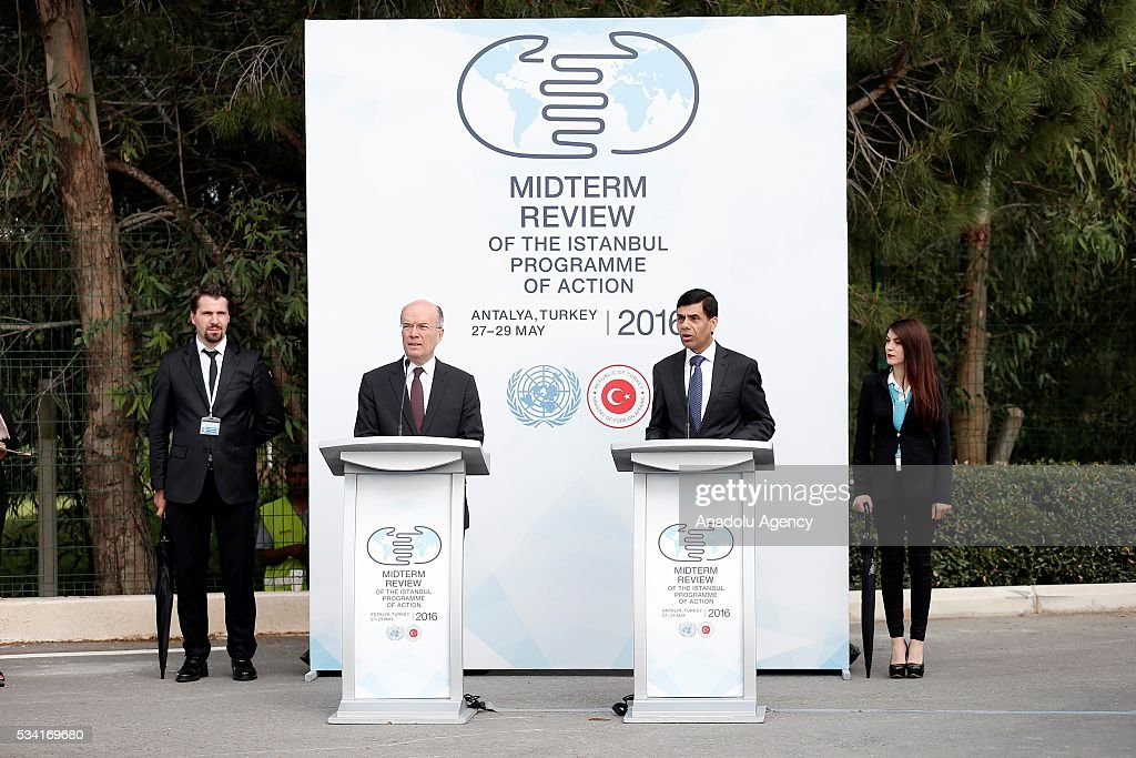 Under-Secretary-General and High Representative for the LDCs Gyan Chandra Acharya (right 2) and Turkey's Deputy Foreing Minister Naci Koru (left 2) attend the ceremony for the raising United Nations flag at the Titanic Hotel where Midterm Review of the Istanbul Programme of Action, in Antalya, Turkey on May 25, 2016. The Midterm Review conference for the Istanbul Programme of Action for the Least Developed Countries will take place in Turkey's Antalya from 27-29 May 2016.
