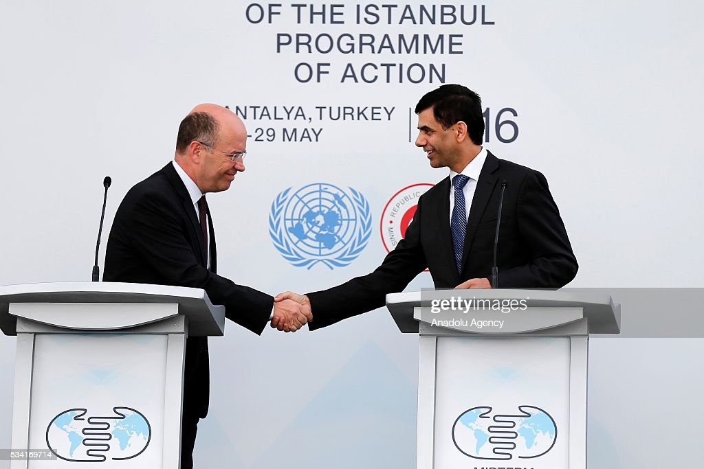 Under-Secretary-General and High Representative for the LDCs Gyan Chandra Acharya (R) and Turkey's Deputy Foreing Minister Naci Koru (L) attend the ceremony for the raising United Nations flag at the Titanic Hotel where Midterm Review of the Istanbul Programme of Action, in Antalya, Turkey on May 25, 2016. The Midterm Review conference for the Istanbul Programme of Action for the Least Developed Countries will take place in Turkey's Antalya from 27-29 May 2016.