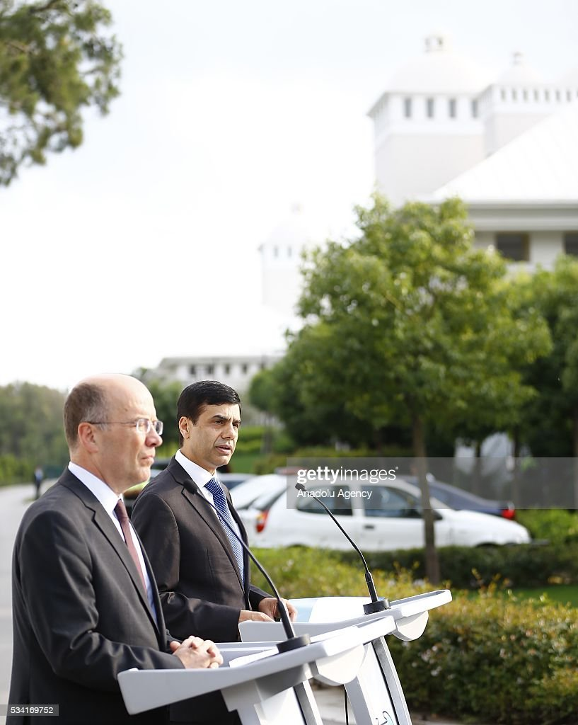 Under-Secretary-General and High Representative for the LDCs Gyan Chandra Acharya (R) and Turkey's Deputy Foreing Minister Naci Koru (L) attend the flag raising ceremony for the flags of the United Nations and Turkey at the Titanic Hotel where Midterm Review of the Istanbul Programme of Action, in Antalya, Turkey on May 25, 2016. The Midterm Review conference for the Istanbul Programme of Action for the Least Developed Countries will take place in Turkey's Antalya from 27-29 May 2016.