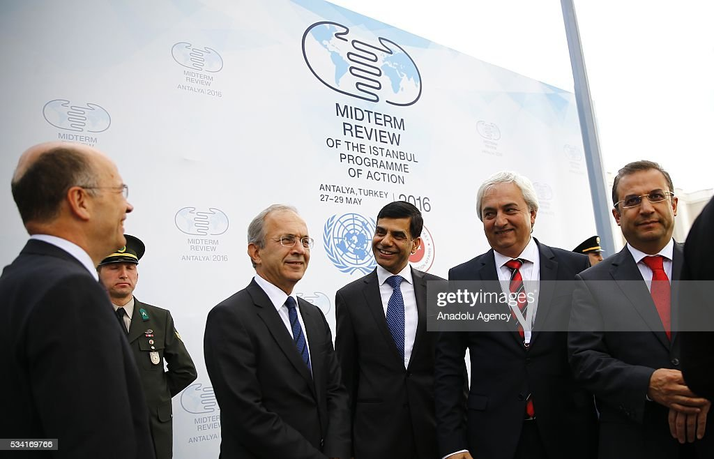 Under-Secretary-General and High Representative for the LDCs Gyan Chandra Acharya (right 3) and Turkey's Deputy Foreing Minister Naci Koru (left) attend the flag raising ceremony for the flags of the United Nations and Turkey at the Titanic Hotel where Midterm Review of the Istanbul Programme of Action, in Antalya, Turkey on May 25, 2016. The Midterm Review conference for the Istanbul Programme of Action for the Least Developed Countries will take place in Turkey's Antalya from 27-29 May 2016.