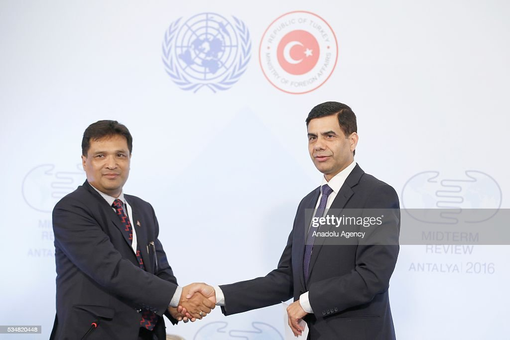 Under-Secretary-General and High Representative for the LDCs Gyan Chandra Acharya (R) and International Coordinator, LDCs Watch Gauri Pradhan (L) shake hands during a press conference within the Midterm Review of the Istanbul Programme of Action at Titanic Hotel in Antalya, Turkey on May 28, 2016. The Midterm Review conference for the Istanbul Programme of Action for the Least Developed Countries takes place in Antalya, Turkey from 27-29 May 2016.
