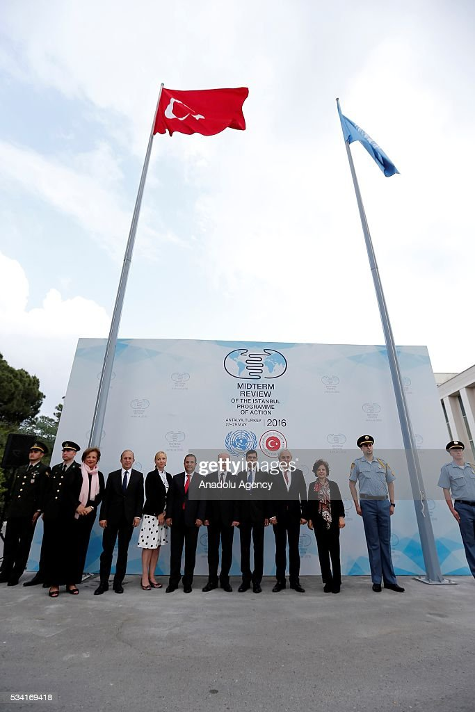 Under-Secretary-General and High Representative for the LDCs Gyan Chandra Acharya (right 5), Turkey's Deputy Foreing Minister Naci Koru (right 6) and Assistant Secretary-General for General Assembly and Conference Management Catherine Pollard (right 3) attend the ceremony for the raising of the United Nations flag at the Titanic Hotel where Midterm Review of the Istanbul Programme of Action, in Antalya, Turkey on May 25, 2016. The Midterm Review conference for the Istanbul Programme of Action for the Least Developed Countries will take place in Turkey's Antalya from 27-29 May 2016.