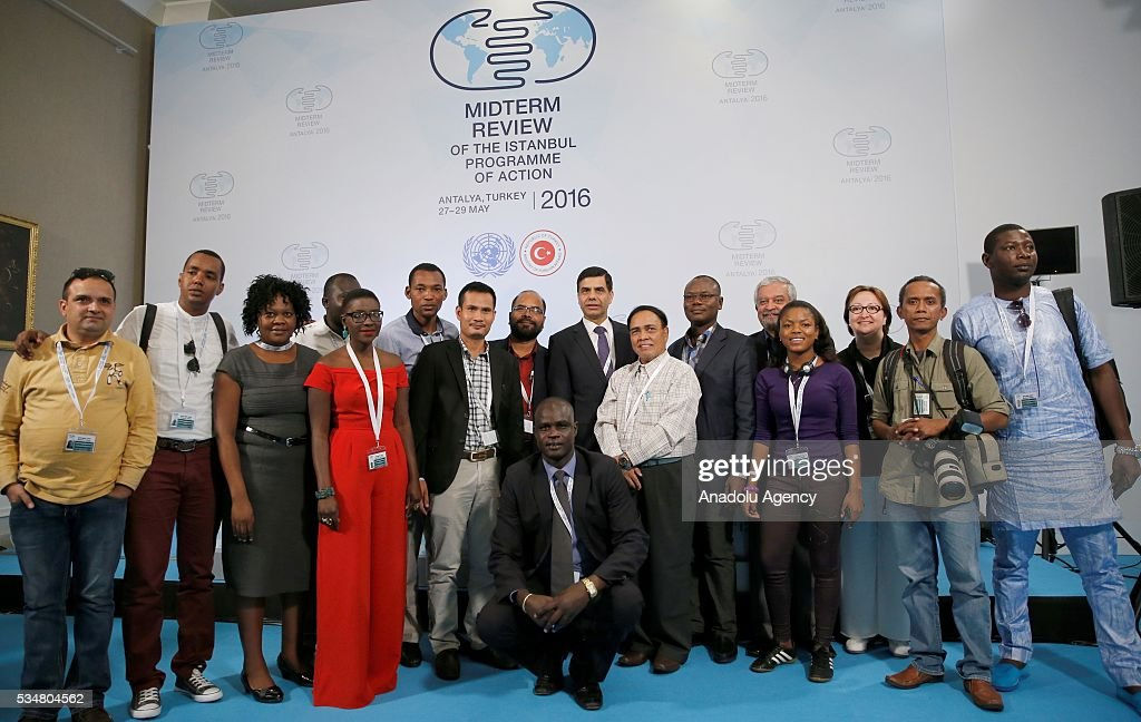Under-Secretary-General and High Representative for the LDCs Gyan Chandra Acharya (C) poses for photo with representatives as he attends a press conference during the Midterm Review of the Istanbul Programme of Action at Titanic Hotel in Antalya, Turkey on May 28, 2016. The Midterm Review conference for the Istanbul Programme of Action for the Least Developed Countries takes place in Antalya, Turkey from 27-29 May 2016.