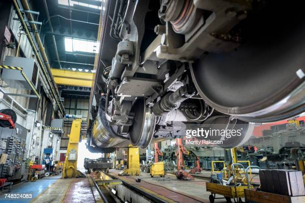 Underside of locomotive in train works