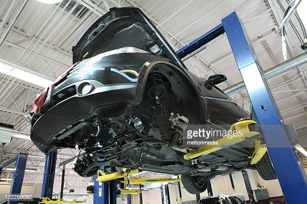 Underside view of a car in an auto repair shop