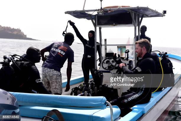 Underwater archaeologist Ibrahima Thiaw and graduate students from Dakar's Chiekh Anta Diop university work on a boat during a diving expedition to...