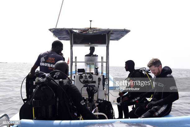 Underwater archaeologist Ibrahima Thiaw and graduate students from Dakar's Chiekh Anta Diop university work on a boat during an expedition to find...