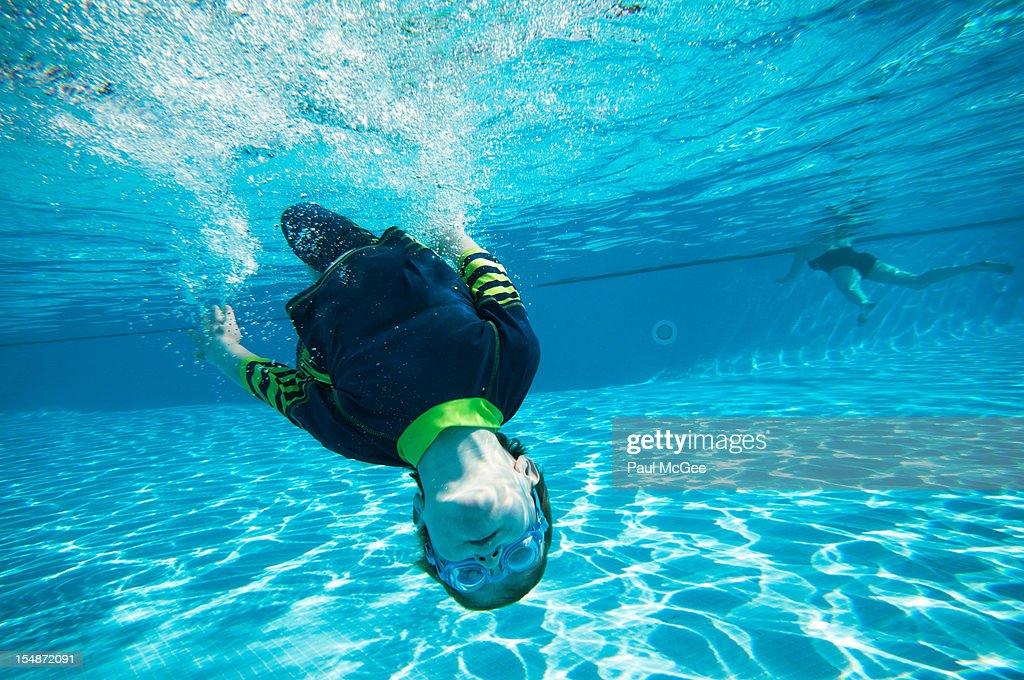 Underwater back flip : Stock Photo