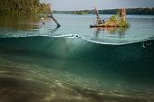 Half underwater half over, over-under split shot of huge Lake Laber
