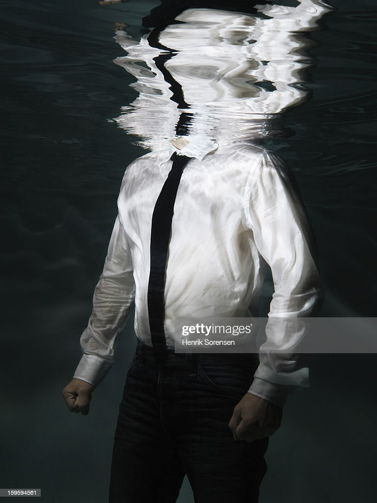 Underwater businessman.(With no head) : Stock Photo