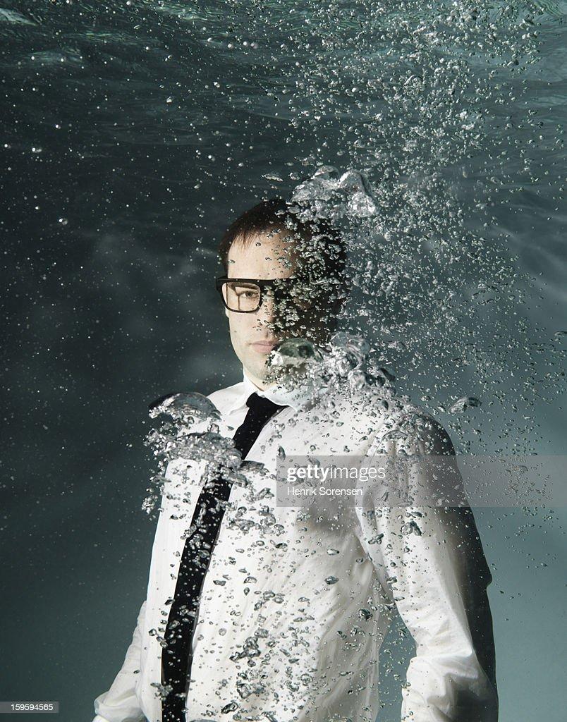 Underwater businessman.