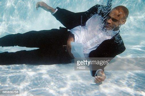 Underwater businessman : Stock Photo