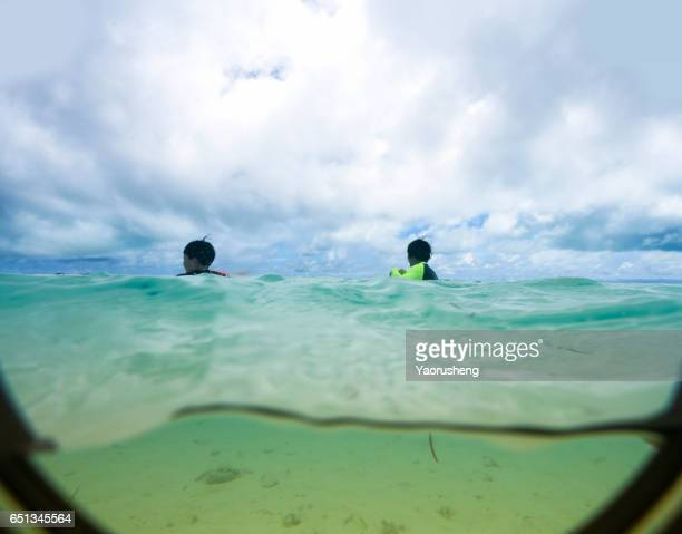 Underwater image of traveller in a tropical sea