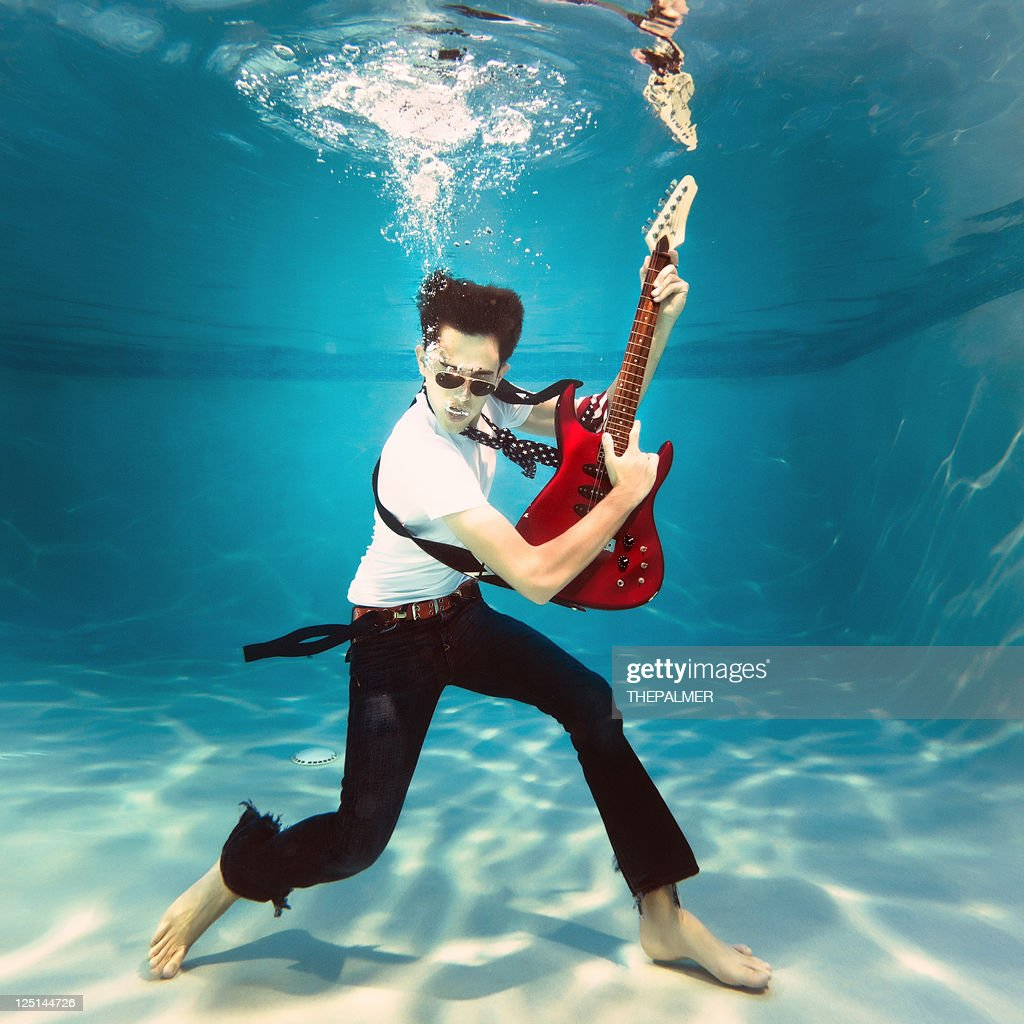 underwater rock and roll : Stock Photo