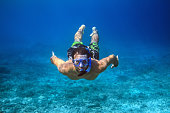 Underwater shoot of a young man snorkeling in a tropical sea. vacation concept