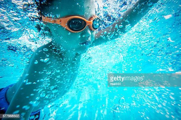 Underwater shot of boy swimming