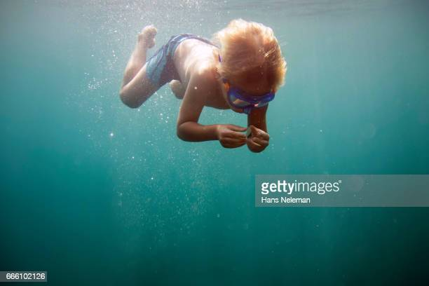Underwater view of boy diving
