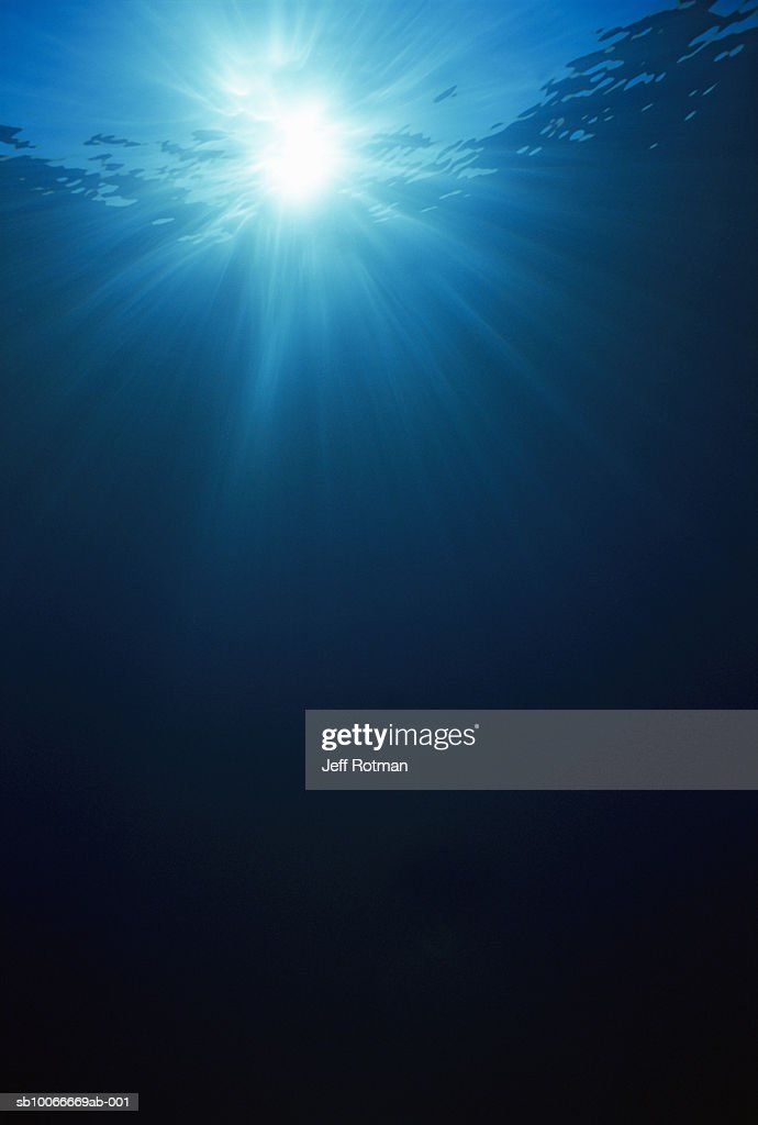 Underwater view of sunbeams : Stock Photo