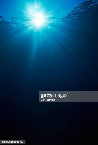 Underwater view of sunbeams
