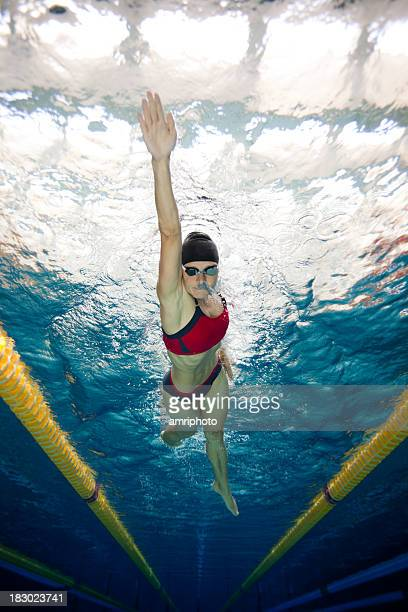 underwater view of woman swimming in lane