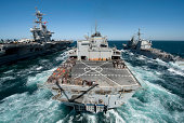 Underway replenishment at sea with U.S. Navy ships in the Arabian Gulf.