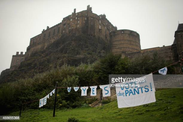 Underwear and laundry hang from a washing line below Edinburgh Castle supporting a Yes vote during the scottish referendum on September 18 2014 in...