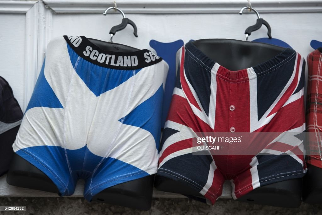 Underwear featuring the Scottish Saltire flag (L) and the Union flag are displayed for sale near to the Scottish Parliament building in Edinburgh, Scotland on June 25, 2016, following the pro-Brexit result of the UK's EU referendum vote. The result of Britain's June 23 referendum vote to leave the European Union (EU) has pitted parents against children, cities against rural areas, north against south and university graduates against those with fewer qualifications. London, Scotland and Northern Ireland voted to remain in the EU but Wales and large swathes of England, particularly former industrial hubs in the north with many disaffected workers, backed a Brexit. / AFP / OLI