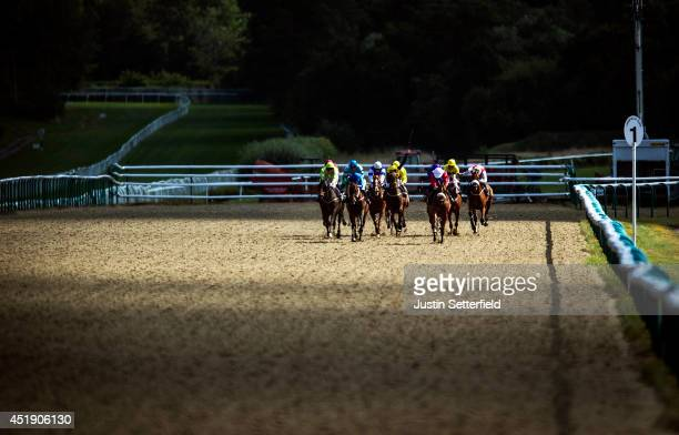 Underwritten riden by Martin Harley leads in the 32Red Casino Handicap at Lingfield Park on July 9 2014 in Lingfield England