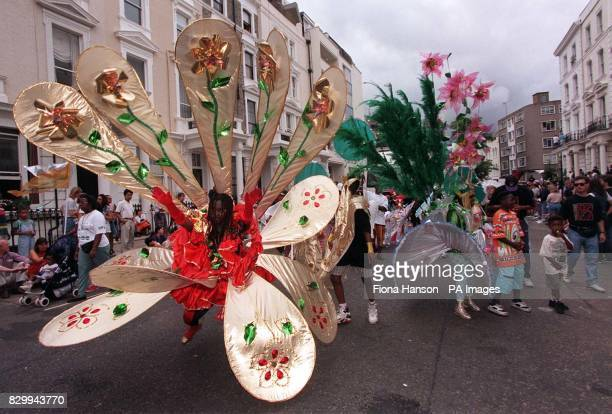 Undeterred by a foreboding grey sky children dressed in colourful costumes take to the streets of west London as the 32nd Notting Hill Carnival gets...