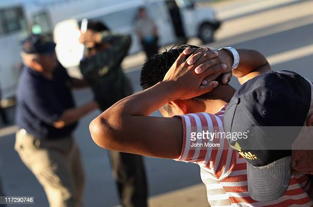Undocumented Guatemalan immigrants are body searched before boarding a deportation flight to Guatemala City Guatemala at PhoenixMesa Gateway Airport...