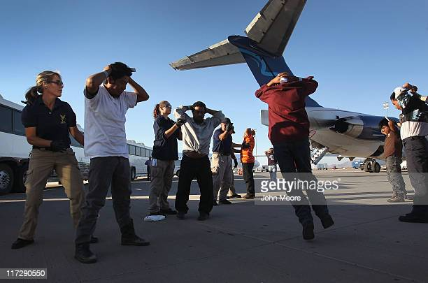 Undocumented Guatemalan immigrants are searched before boarding a deportation flight to Guatemala City Guatemala at PhoenixMesa Gateway Airport on...