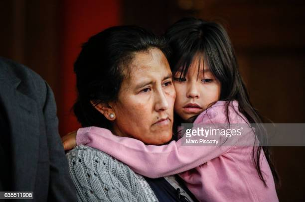Undocumented immigrant and activist Jeanette Vizguerra hugs her youngest child Zury Baez while addressing supporters and the media as she seeks...