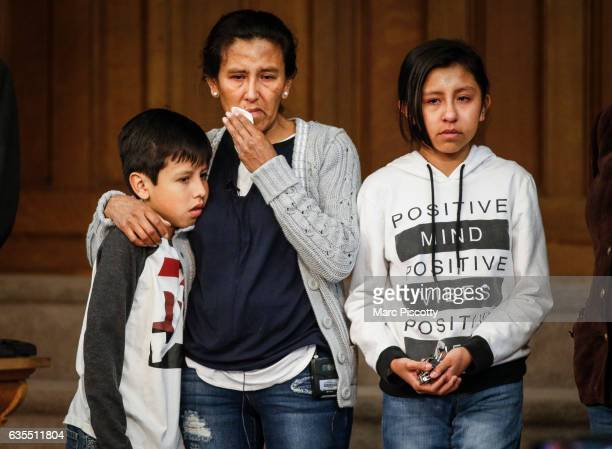 Undocumented immigrant and activist Jeanette Vizguerra stands with her children Roberto and Luna Baez as she addresses supporters and the media while...