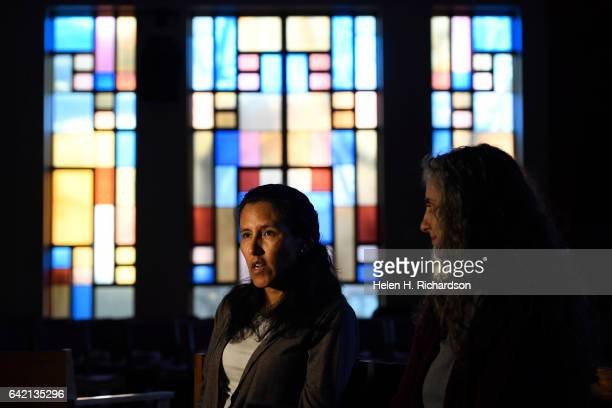 Undocumented immigrant Jeanette Vizguerra left with her interpreter Jennifer Piper right is pictured in the sanctuary of the First Unitarian Church...