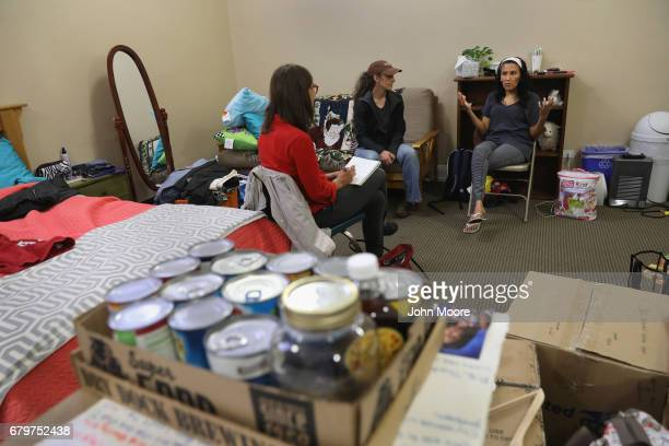Undocumented immigrant Jeanette Vizguerra speaks with a reporter while taking sanctuary at the First Baptist Church on May 5 2017 in Denver Colorado...