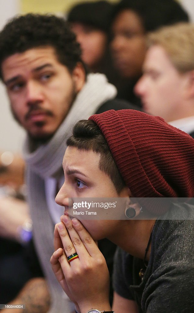 Undocumented immigrant Katherine Taberes (BOTTOM), originally from Colombia, watches during a watch party of President Barack Obama's speech on immigration on January 29, 2013 in the Queens borough of New York City. Obama called for immigration reform and a 'pathway to citizenship' for the nation's 11 million undocumented immigrants.