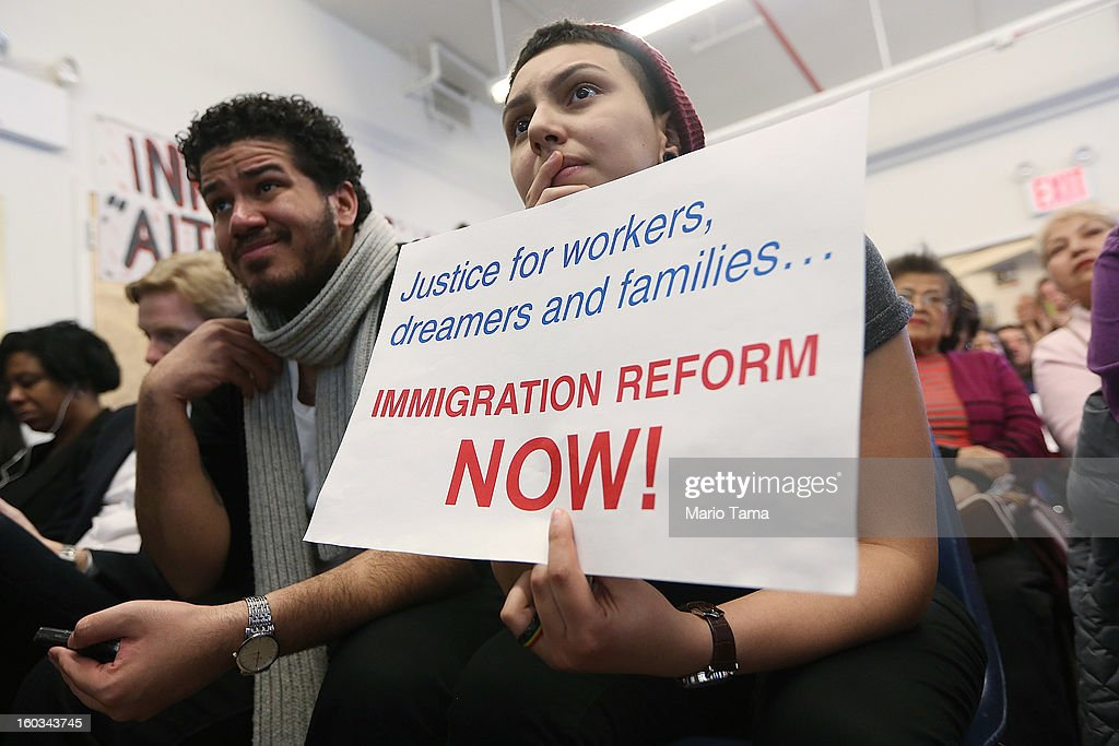Undocumented immigrant Katherine Taberes (R), originally from Colombia, watches with Giovanni Matos during a watch party of U.S. President Barack Obama's speech on immigration on January 29, 2013 in New York City. Obama called for immigration reform and a 'pathway to citizenship' for the nation's 11 million undocumented immigrants.