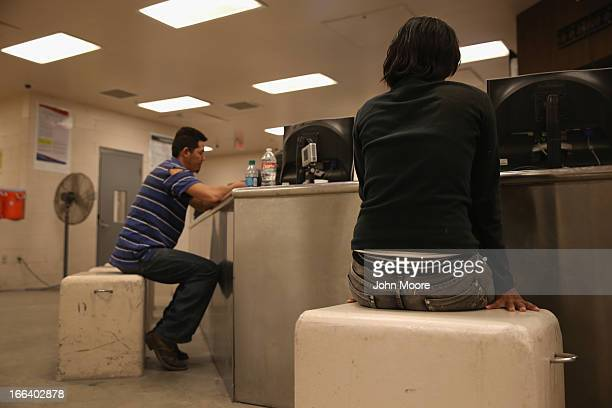 Undocumented immigrants are processed for deportation at the US Border Patrol detainee processing center on April 11 2013 in McAllen Texas According...