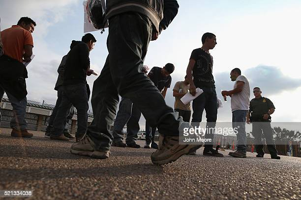 Undocumented immigrants await deportation by Border Patrol agents at the USMexico border on April 13 2016 in Hidalgo Texas Border security and...