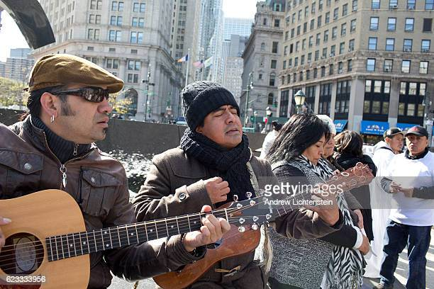 Undocumented immigrants many who have lived in America for decades but still face the threat of sudden deportation hold a protest march and prayer in...