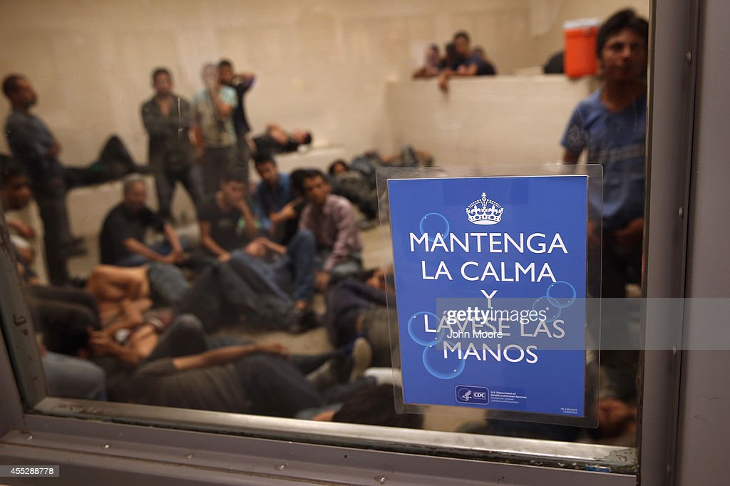 Undocumented immigrants wait in a holding cell at a US Border Patrol processing center for people detained near the USMexico border on September 8...