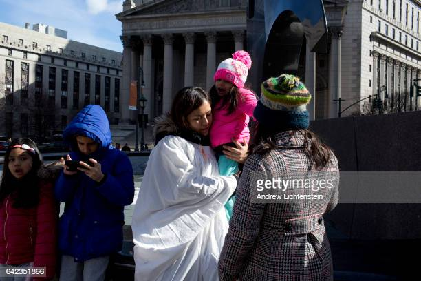 Undocumented immigrants who are members of the church based Sanctuary Movement hold a prayer vigil outside of the United States Citizenship and...