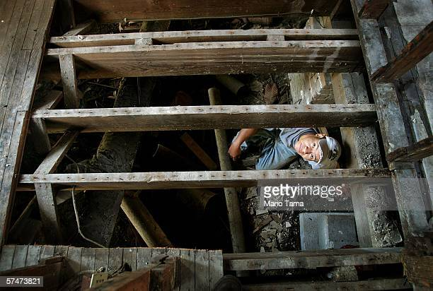 Undocumented laboborer Jose from Mexico looks up while performing 'house leveling' work to a home damaged by Hurricane Katrina April 27 2006 in New...