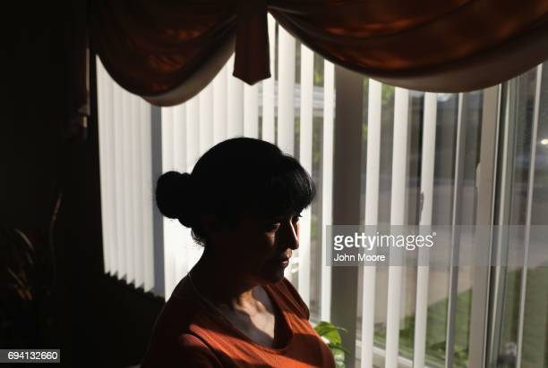 Undocumented Mexican immigrant Adela Banuelos whos five children were born in the US looks out from her home on June 7 2017 in Denver Colorado She...