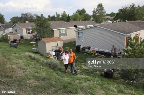 Undocumented Mexican immigrant Arturo Hernandez Garcia stands with his wife Ana Sauzamera ouside their family home on June 6 2017 in Thornton...