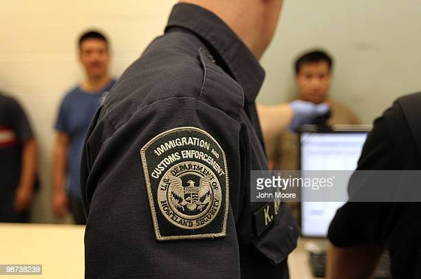 Undocumented Mexican immigrants are photographed while being inprocessed at the Immigration and Customs Enforcement center on April 28 2010 in...