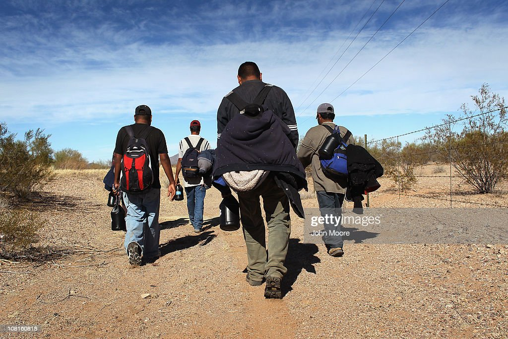 Undocumented Mexican immigrants walk through the Sonoran Desert after illegally crossing the USMexico border border on January 19 2011 into the...