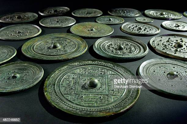 Unearthed copper mirrors registered as national treasure are arranged for the shooting on July 28 2015 in Munakata Fukuoka Japan The Council for...